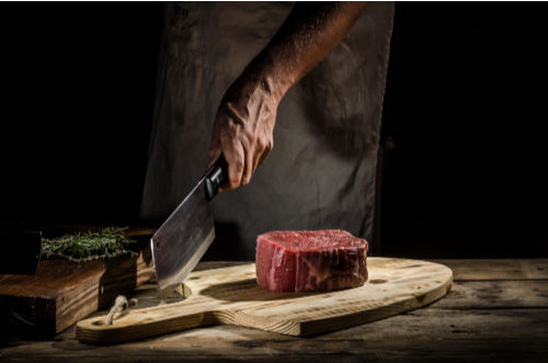 Chopping Meat on a board