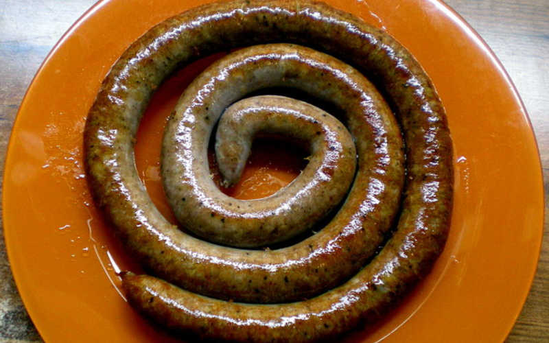A coil of botifarra on a plate